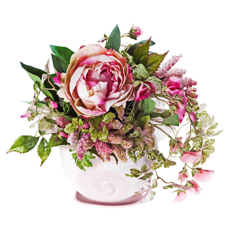 Colorful bouquet from roses and peon flowers in vase isolated on white. Closeup.