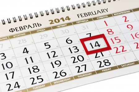 Calendar page with red frame on February 14 2014. Closeup. photo