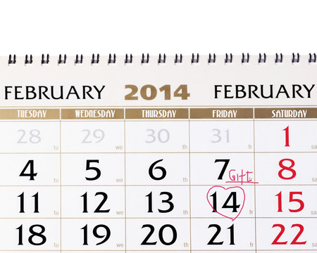 Calendar page with red heart on February 14 2014. Closeup. photo