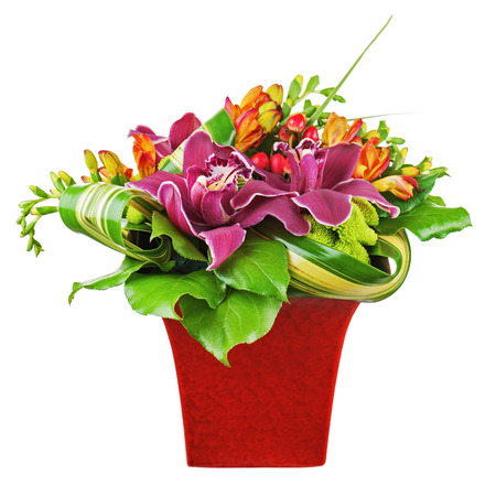 Bouquet from orchids and lilies in red vase isolated on white background  Closeup  Stock Photo