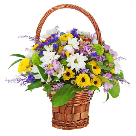 Bouquet from gerbera flowers in wicker gift basket isolated on white background.  photo