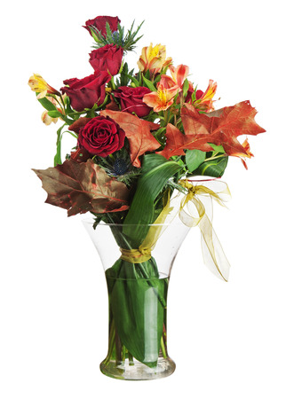 Floral bouquet of roses and lilies arrangement centerpiece in glass vase isolated on white background  Closeup  photo