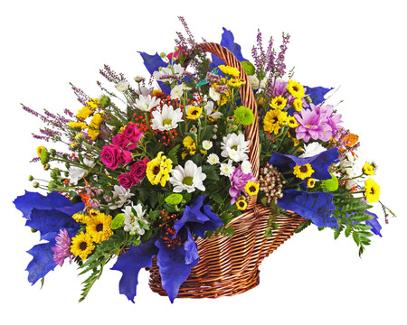 Flowers bouquet arrangement centerpiece in wicker basket isolated on white background  Closeup  photo