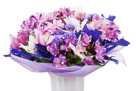 Bouquet from orchids and lilies in vase isolated on white background  Closeup  photo
