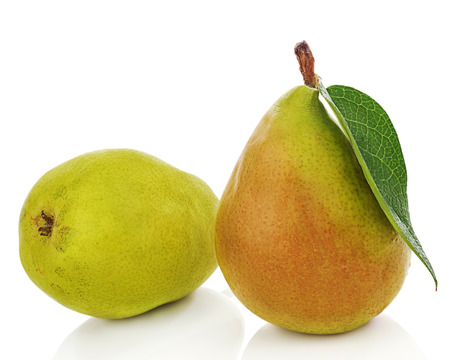 Pears with green leaves isolated on white background. Closeup. Stock Photo