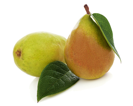 Pears with green leaves isolated on white background. Closeup. photo