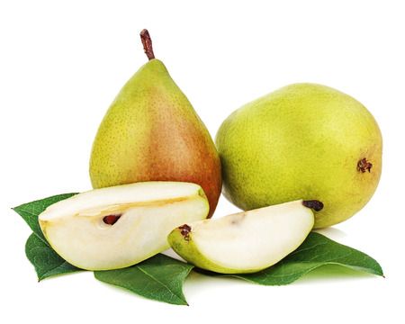 Pears with cut and green leaves isolated on white background. Closeup.