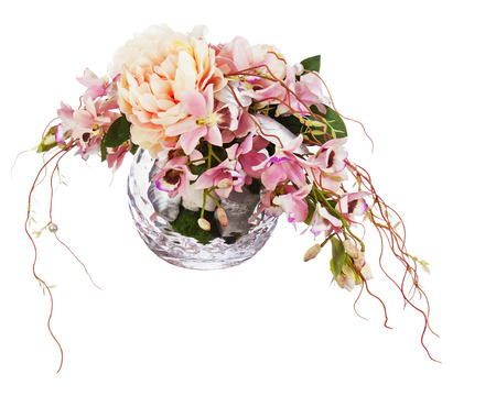 Bouquet from peon flowers and orchids in glass vase isolated on white  photo