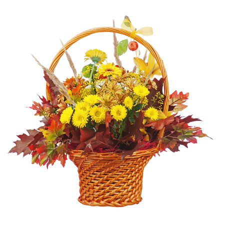 Bouquet arrangement centerpiece in wicker basket isolated on white  photo