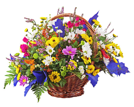 Flowers bouquet arrangement centerpiece in wicker basket isolated on white background. Closeup.