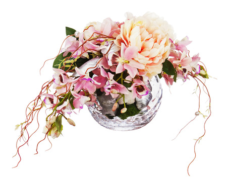 Bouquet from peon flowers and orchids in glass vase isolated on white background. Closeup. photo