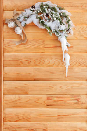 Christmas decoration and fir tree on wooden background. photo