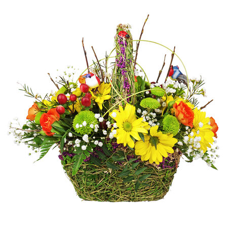 Flowers bouquet arrangement centerpiece in wicker basket isolated on white background. photo