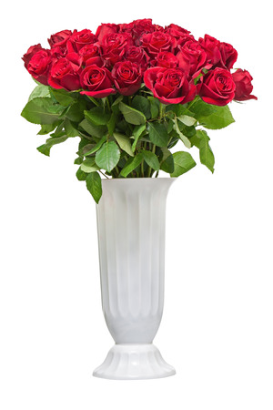 Colorful flower bouquet from red roses in white vase isolated on white background. photo