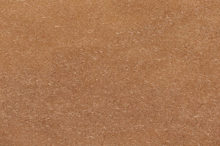 Recycled compressed wood chipboard. Useful for designers as background. Closeup. photo