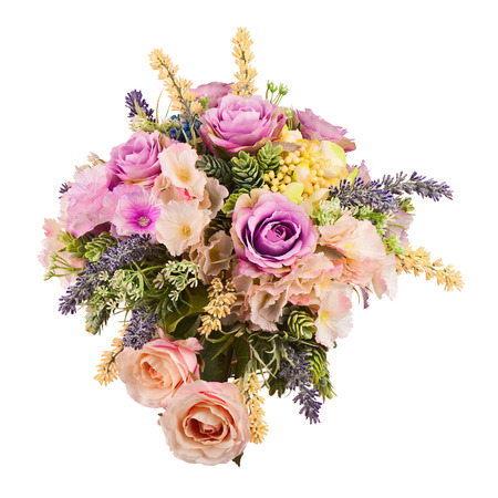 Bouquet from artificial flowers arrangement centerpiece in vase isolated on white background.