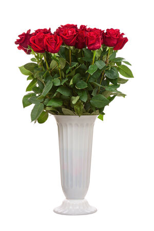 Flower bouquet from red roses in vase isolated on white background. Closeup. photo