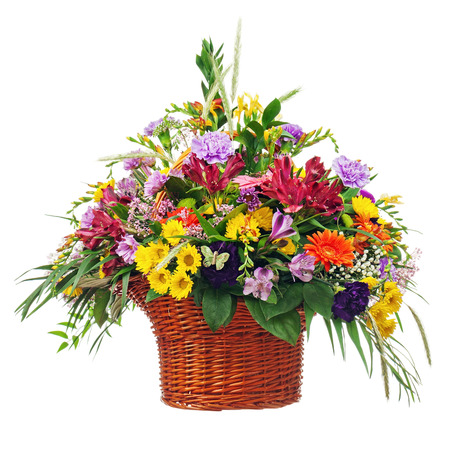 Colorful Flower Bouquet Arrangement Centerpiece in Basket Isolated on White Background. Closeup. photo