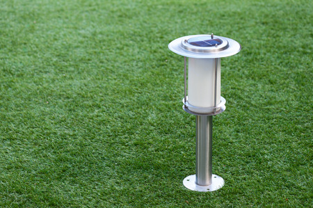 powered: Solar Powered Lamp on Garden Background. Selective Focus. Stock Photo
