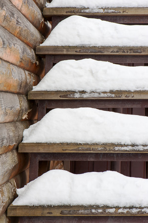 powdery: Powdery snow covered old wooden stairs. Abstract winter background composition.