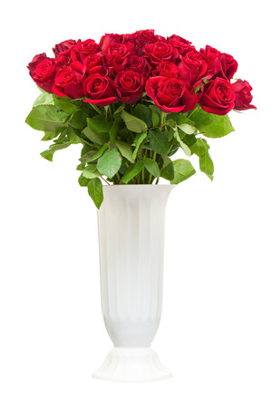 roses in vase: Colorful flower bouquet from red roses in white vase isolated on white background. Stock Photo