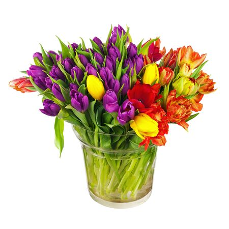 Flower bouquet from colorful tulips in glass vase isolated on white background. photo
