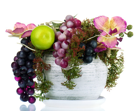 Colorful Composition Made Of Artificial Flowers And Fruits In