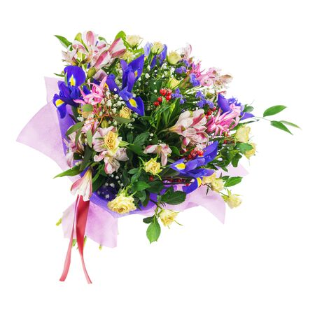 Delicate beautiful bouquet of nerine, iris, alstroemeria, roses and other flowers in pink packaging with red tape isolated on white background. Stock Photo