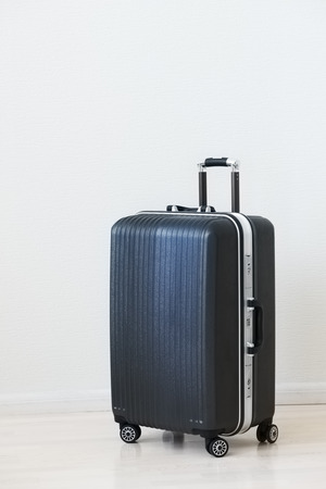 polycarbonate: Large family polycarbonate luggage on white wooden background.