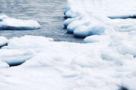 breaking up: Natural sea ice blocks breaking up against shore and ice during freezing winter weather. Stock Photo