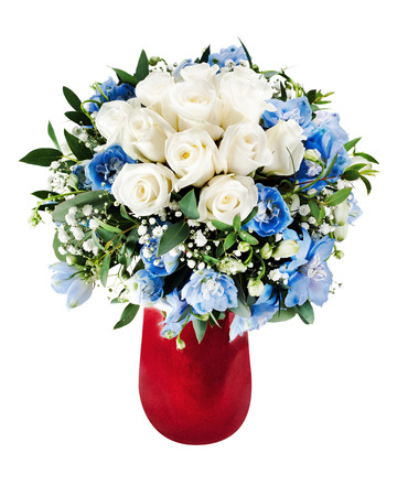 arrangment: Colorful floral bouquet from white roses and delphinium flowers arrangment centerpiece in red vase isolated on white background.
