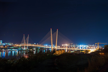 Night view of the bridge in the Russian Vladivostok over the Golden Horn bay.
