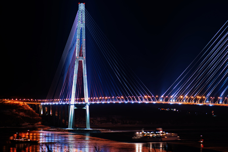 night view of the longest cable-stayed bridge in the world in the Russian Vladivostok over the Eastern Bosphorus strait to the Russky Island