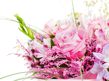 fragment of colorful bouquet of roses, cloves, orchids and freesia isolated on white background
