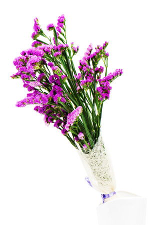 Bouquet from purple statice flowers arrangement centerpiece in bouquet from purple statice flowers arrangement centerpiece in vase isolated on white background stock photo mightylinksfo