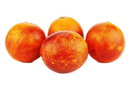 Ripe red blood oranges isolated on white background. Closeup.