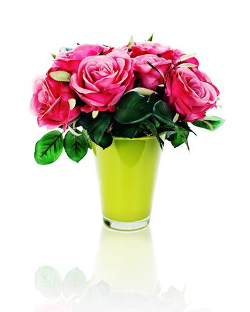 Colorful flower bouquet from artificial roses arrangement centerpiece in vase isolated on white background