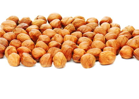 Hazelnuts background isolated on white background. Closeup.