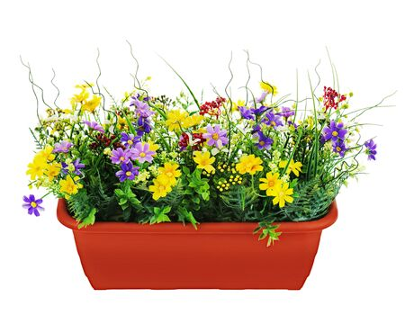 Composition of artificial garden flowers in decorative flowerpot isolated on white background.
