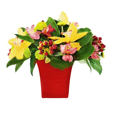 Colorful flower bouquet from orchids and lilies arrangement centerpiece in red vase isolated on white background. Stock Photo