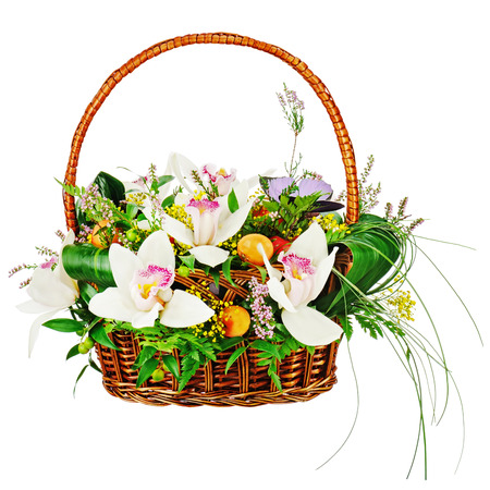 Bouquet from orchids in in wicker basket isolated on white background. Closeup.