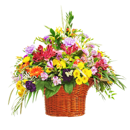 contrast floral: Flower bouquet arrangement centerpiece in wicker basket isolated on white background. Closeup. Stock Photo