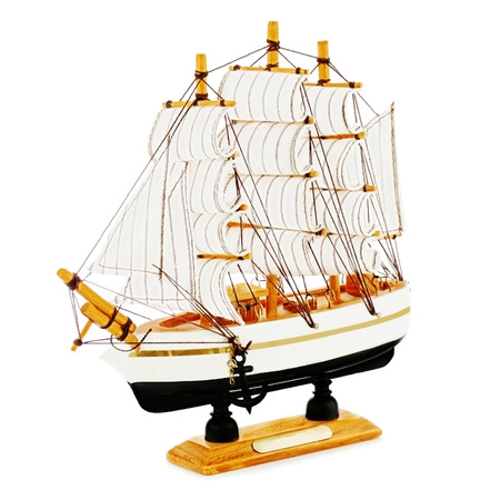 Old sailboat model isolated on white background. Closeup. Stock Photo