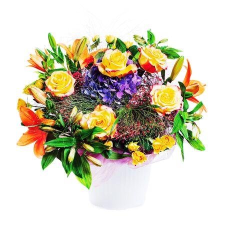 Flower bouquet arrangement centerpiece in vase isolated on white background.