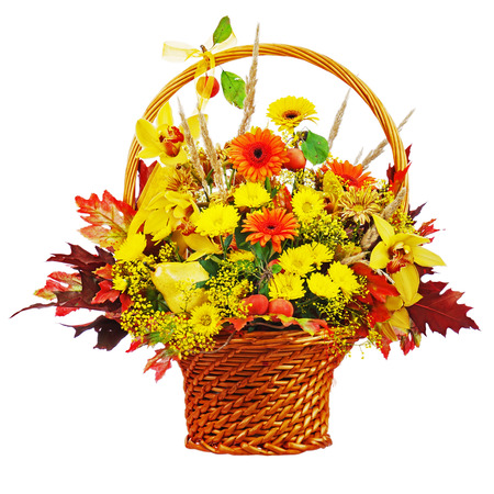 Colorful flower bouquet arrangement centerpiece in wicker basket isolated on white background. Closeup. Stock Photo