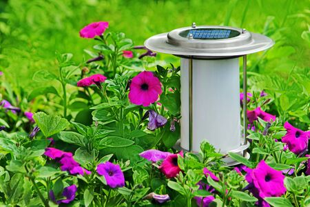 Solar powered save energy garden lamp. Closeup.