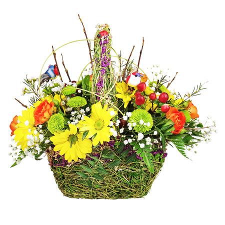 Flowers bouquet arrangement centerpiece in wicker basket isolated on white background.