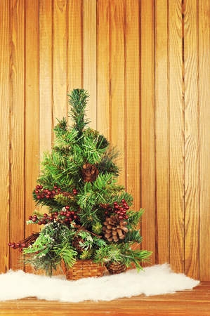 Christmas composition from pine tree and decorations on wooden background with place for your wording. Stock Photo