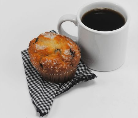Coffee and muffin on isolated white background Stock Photo