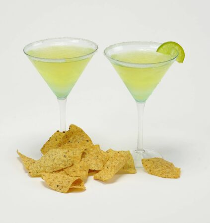 Margaritas and chips on isolated white background